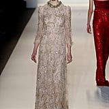 Anne Hathaway's vintage sensibilities and girlie pixie cut would mesh nicely with this feminine beaded Jenny Packham dress.