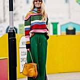 Pick out a colour from a bright, striped sweater and wear it on bottom for a vivid look. Bonus points for a even brighter bag.