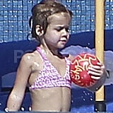 Honor Warren carried a ball into the pool.