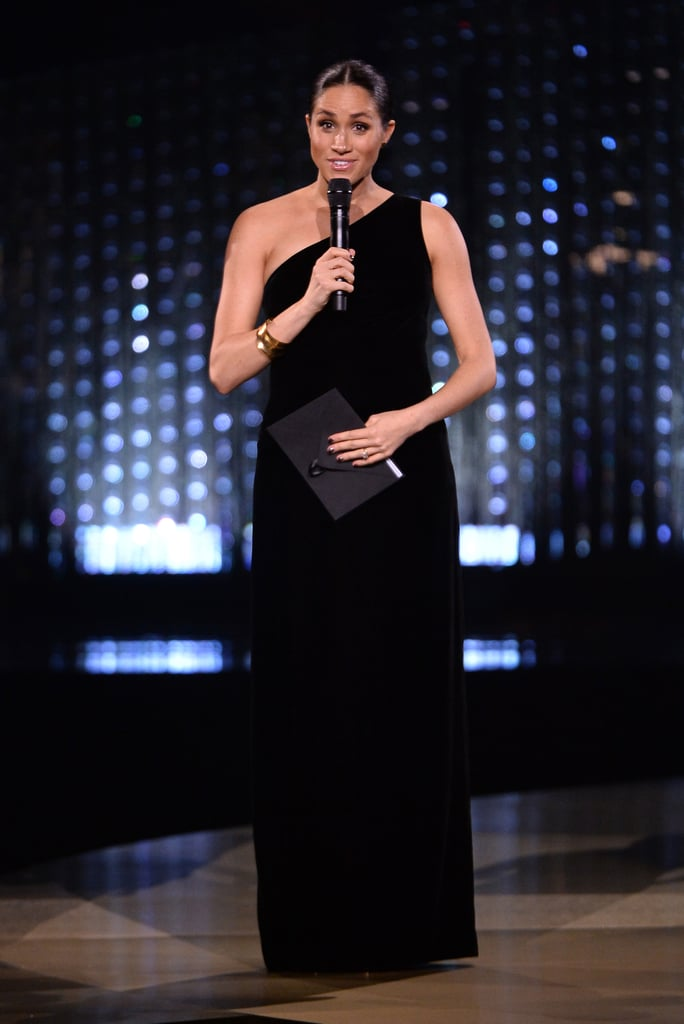 When Meghan Markle makes a surprise appearance, the whole world pays attention. The Duchess of Sussex showed up at the 2018 Fashion Awards in London on Dec. 10 to award Givenchy's Clare Waight Keller with a special honour, and it's damn near impossible to stop thinking about her dress.  Clare is the brilliant mind behind the famous royal's breathtaking wedding dress, so it's no surprise Meghan was given the honour of presenting her with the British designer of the year award. Meghan frequently gravitates towards Givenchy designs, and chose a one-shoulder fitted gown for the awards. She paired the look with gold Tamara Mellon heels and Pippa Small jewellery, but her greatest accessory had to be the glow she gave off as she cradled her growing belly. Once again, her maternity style is totally on point. Check out more angles of Meghan's look ahead — it will leave you speechless.       Related:                                                                                                           Meghan Markle's Style Gets an F in Our Books — For Fabulous!