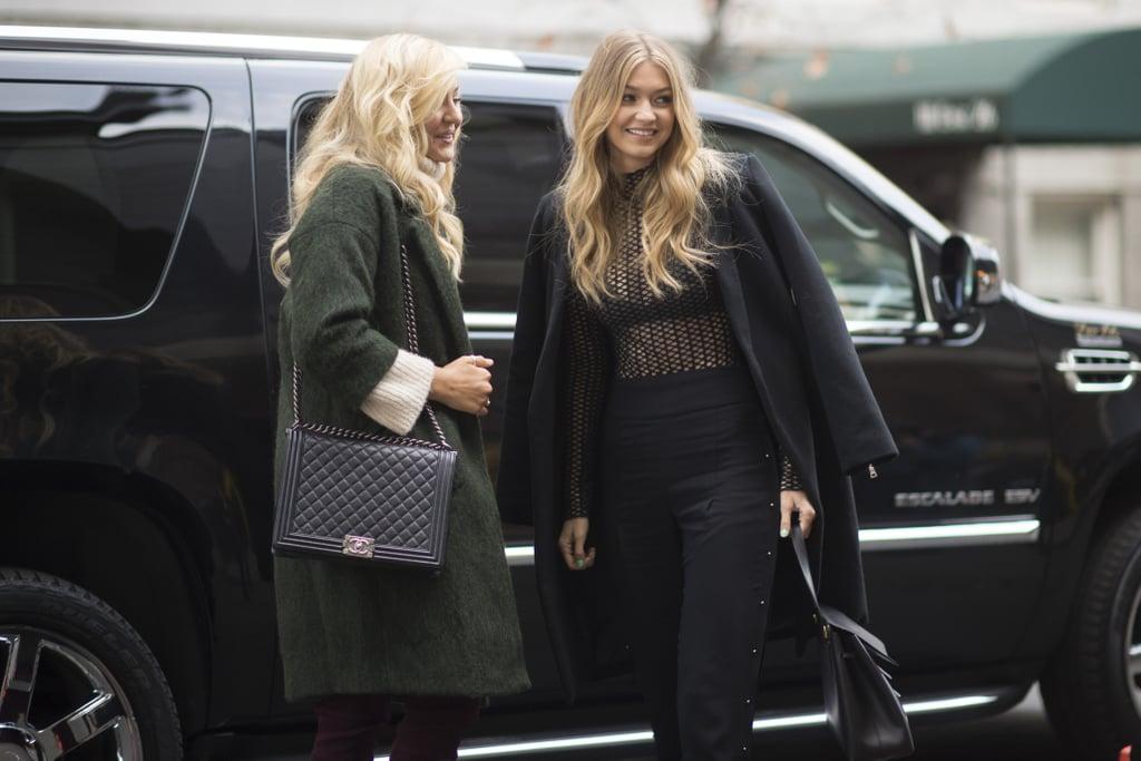 2e571a23b4c Models Gigi Hadid and Rachel Hilbert headed into rehearsal on Monday  wearing cozy oversize coats.