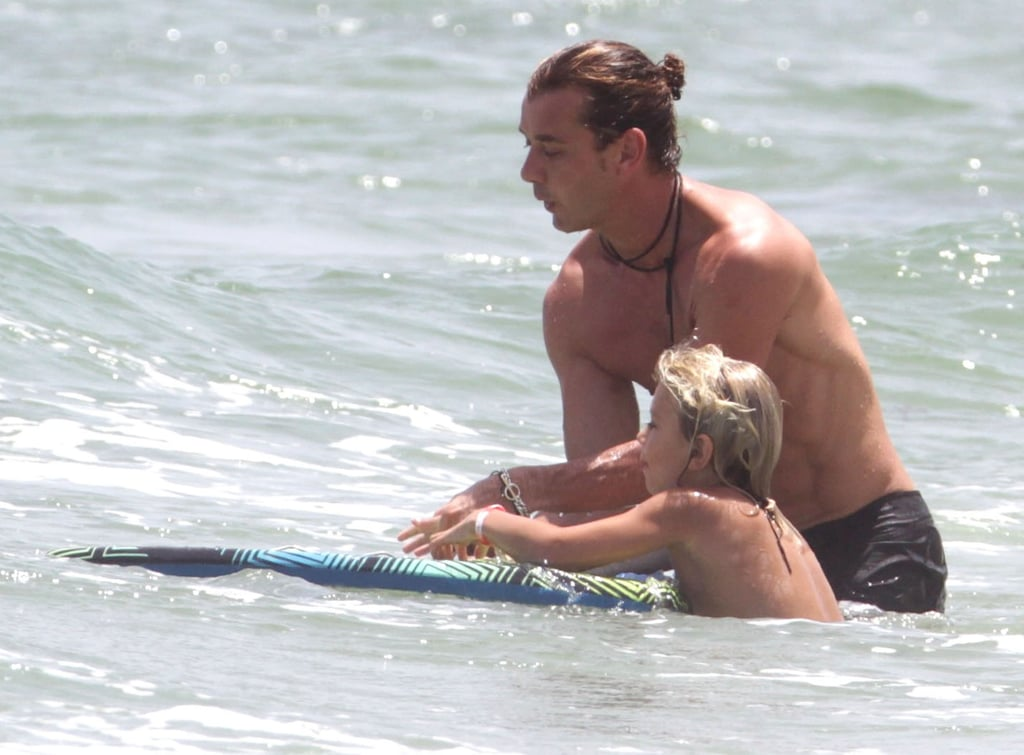 Shirtless Gavin Rossdale boogie boarded with Kingston Rossdale.