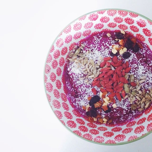 Getting breakfast envy from this bowl? Try the recipe yourself. Blend one Pitaya Plus pack, 1/4 cup frozen blackberries, and 1/4 cup frozen cherries. Top with your choice of chia seeds, hemp seeds, cacao nibs, goji berries, and almonds.