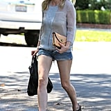 Kirsten Dunst sported sunglasses and cutoff jean shorts.