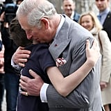 Prince Charles embraced a young boy in Bucharest, Romania, during his European tour.