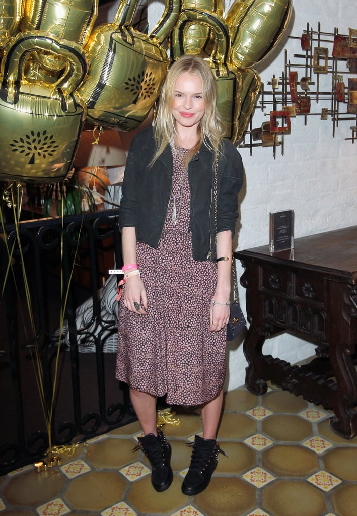 Kate Bosworth donned a tea-length floral-print dress with a black cropped jacket and untied biker-inspired boots at the Mulberry fire pit party.
