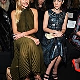 Jessica Hart and Jena Malone sat side by side at J. Mendel, Jessica in an olive-green dress and Jena embracing metallics in a celestial top and matching miniskirt, all by J. Mendel.