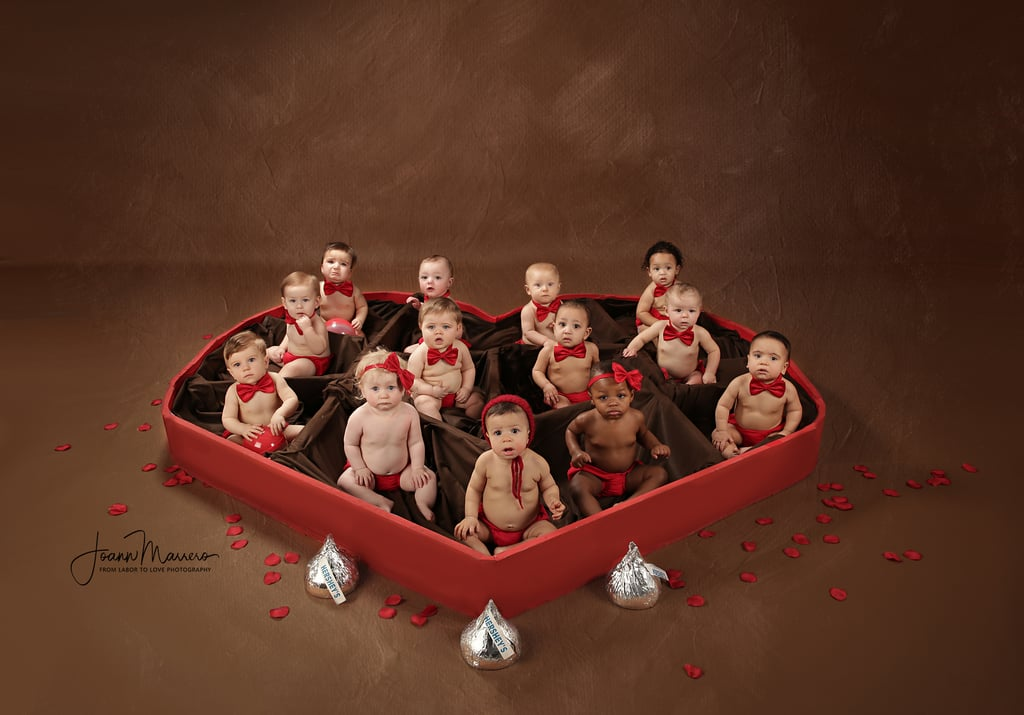 "Photographer JoAnn Marrero of From Labor to Love has managed to do the impossible by taking adorable photos of 13 babies at one time for Valentine's Day. Based in Rocky Hill, CT, she decided to put a call out for babies whose parents were interested in doing a chocolate-box-themed shoot inspired by her son's reaction to his Valentine's Day gift years ago. ""My favorite memory of Valentine's Day was when my youngest son, Alexander, opened up his Valentine's Day present when he was 2-and-a-half years old,"" JoAnn told POPSUGAR. ""Not realizing what was inside, he started yelling to his older brother, Michael, that there was candy inside. His reaction was so cute, it didn't dawn on me that he wouldn't know what was in there."" Believe it or not, staging a shoot with 13 babies wasn't as difficult as JoAnn thought, especially because she had worked with many of them before. Her main goal? Getting everyone involved in the series to enjoy themselves. ""I just wanted a good, fun time with no expectations,"" she said. ""It was just one giant play date!"" Keep reading to get a look at this adorable photo series, which will no doubt warm your heart.      Related:                                                                                                           A Photographer Staged a Newborn Shoot For an English Bulldog Puppy, and the Results Will Give You Heart Eyes"