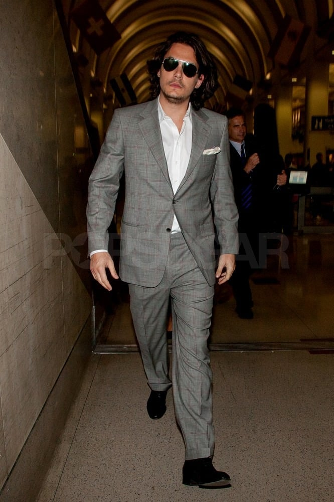 John Mayer touched down at LAX last night looking dapper in his latest gray suit accessorized with a pocket square. The single singer returned to the West Coast after spending much of the Winter in Manhattan whispering to dogs and fighting off romance rumors. John's now embracing the Spring-cleaning ritual by trying to clear out some  highly discounted branded merchandise. He's also back to blogging, although less frequently than he has in the past. His latest entry suggests he may be penning new tunes as well as sticking to his usual gym session.