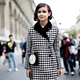 Miroslava Duma knows what time it is with her Charlotte Olympia clutch.