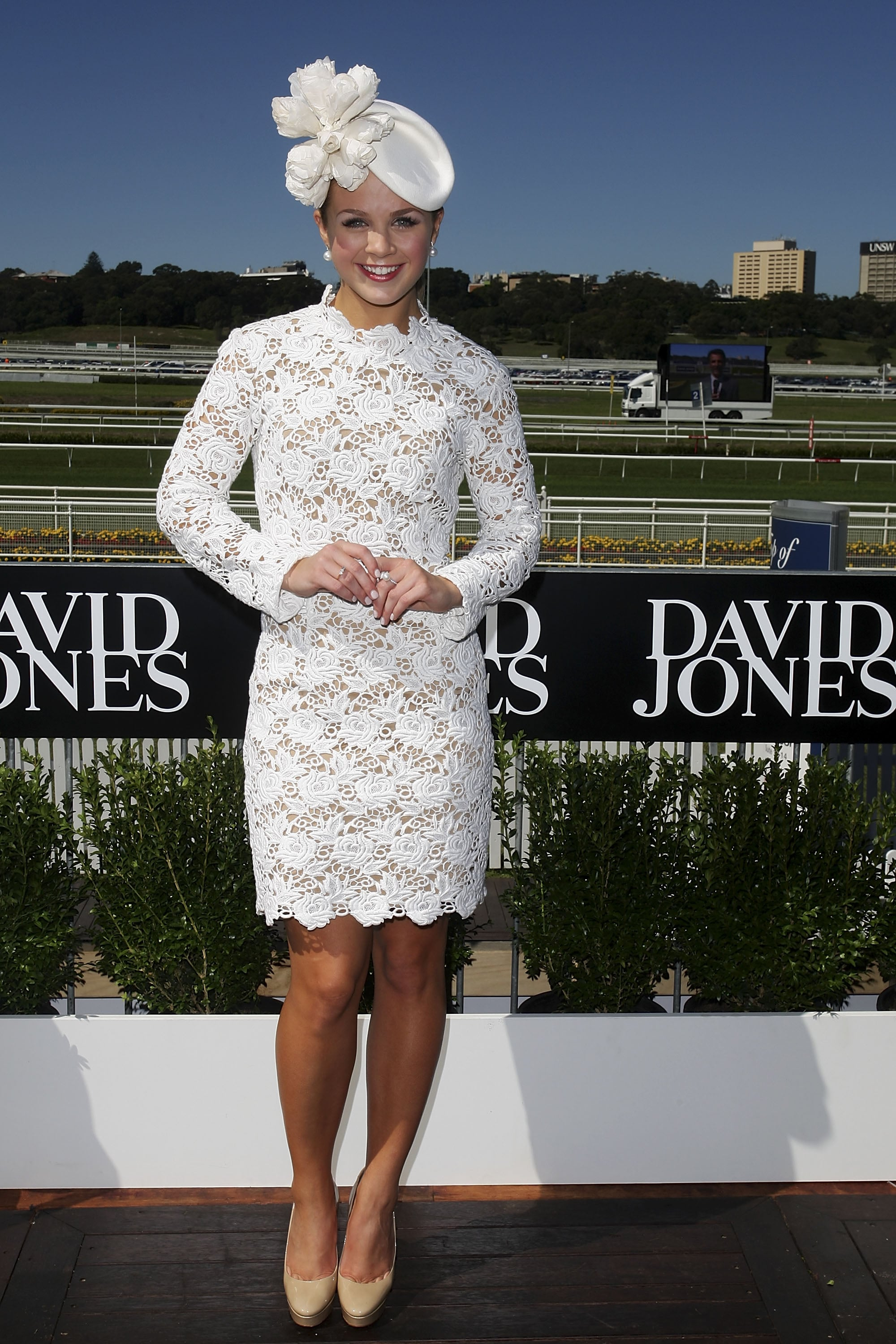 Emma Freedman went all white in a Collette Dinnigan long sleeved dress and Nerida Winter hat.