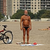 A man soaks up the rays on Coney Island ahead of the expected storm this weekend.
