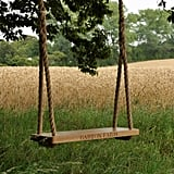 Give your backyard a royal touch by adding your very own rustic rope Oak Garden Swing.