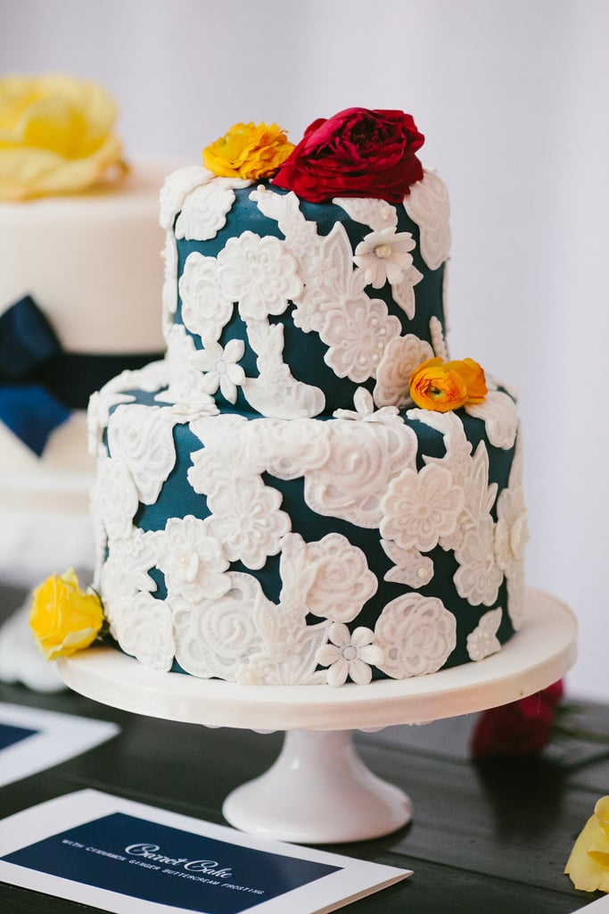 Don't the floral embellishments of this darling cake remind you of doilies? Not your grandma's doilies, though — set against a deep blue base, these are ultrachic.  Photo by Pen/Carlson via Style Me Pretty