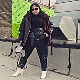 A Shearling Jacket Over Leather Trousers and White Boots