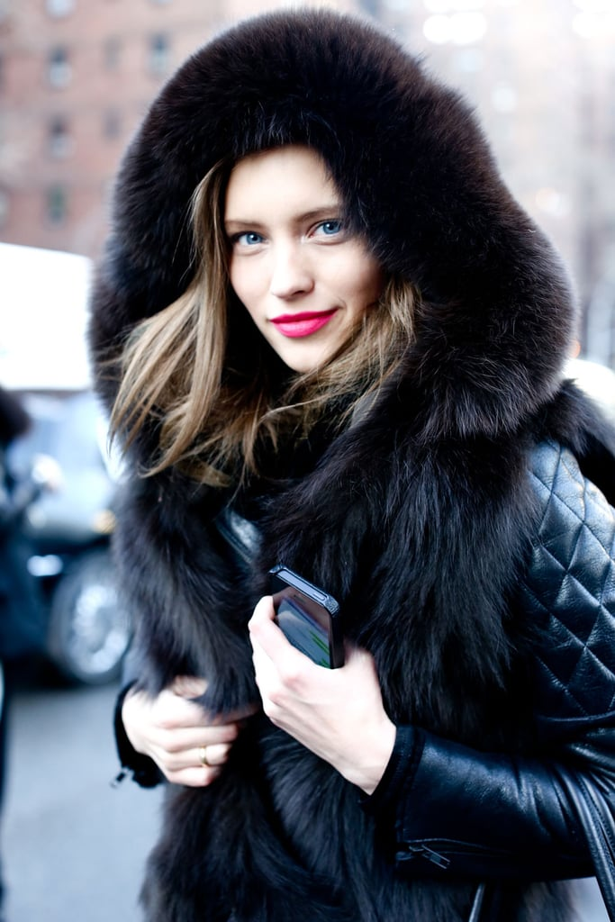 Tucked away inside her Winter-appropriate fur-lined jacket, this woman gave us just a hint of Spring across her lips.