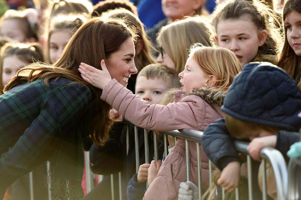The Duchess of Cambridge made an adorable new friend on her trip to Dundee, Scotland, with Prince William — all thanks to her famous blow dry! On Jan. 29, the Duchess of Cambridge greeted the Dundee crowd and knelt down to meet a few of her small fans, as she frequently does with young children. As Kate got down to eye-level with the kids, a certain little girl was so caught up in their conversation that she started mindlessly playing with the royal's iconic chestnut curls while they talked. Kate noticed the sweet gesture and burst into giggles — the perfect reaction!  As a mom of three, it's likely that Kate Middleton often handles moments like this from her own children. While she does have her fair share of parenting struggles, she's a pro at defusing tantrums before they begin, interacting with little ones, and explaining confusing moments in kid-friendly terms. It's no wonder her smallest fans feel so comfortable around her!       Related:                                                                                                           A Kid Touched Meghan Markle's Hair, and He Had an Adorable Reaction When Harry Told Him Off
