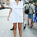 Leandra Medine's shirt dress might as well be borrowed from the boys, but her high heels add quite the statement.