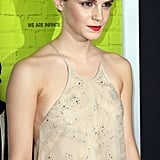 Emma slicked back her hair and went with strong brows and red lips.