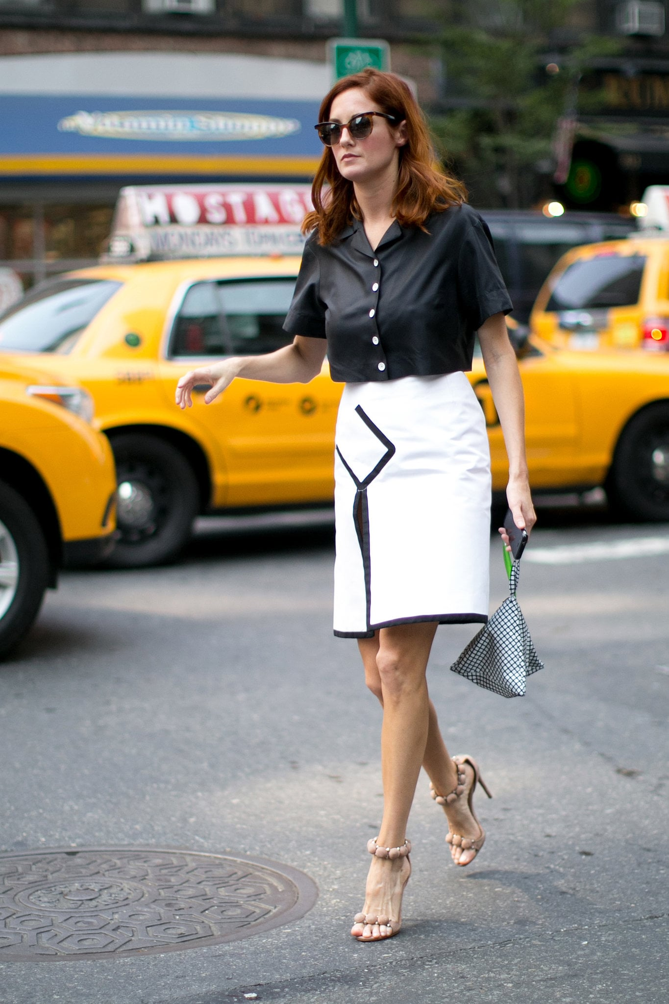 Taylor Tomasi Hill had just the right black and white formula for a sticky Summer day. Keep your top boxy and easy, and add a fresh white pencil skirt for contrast.