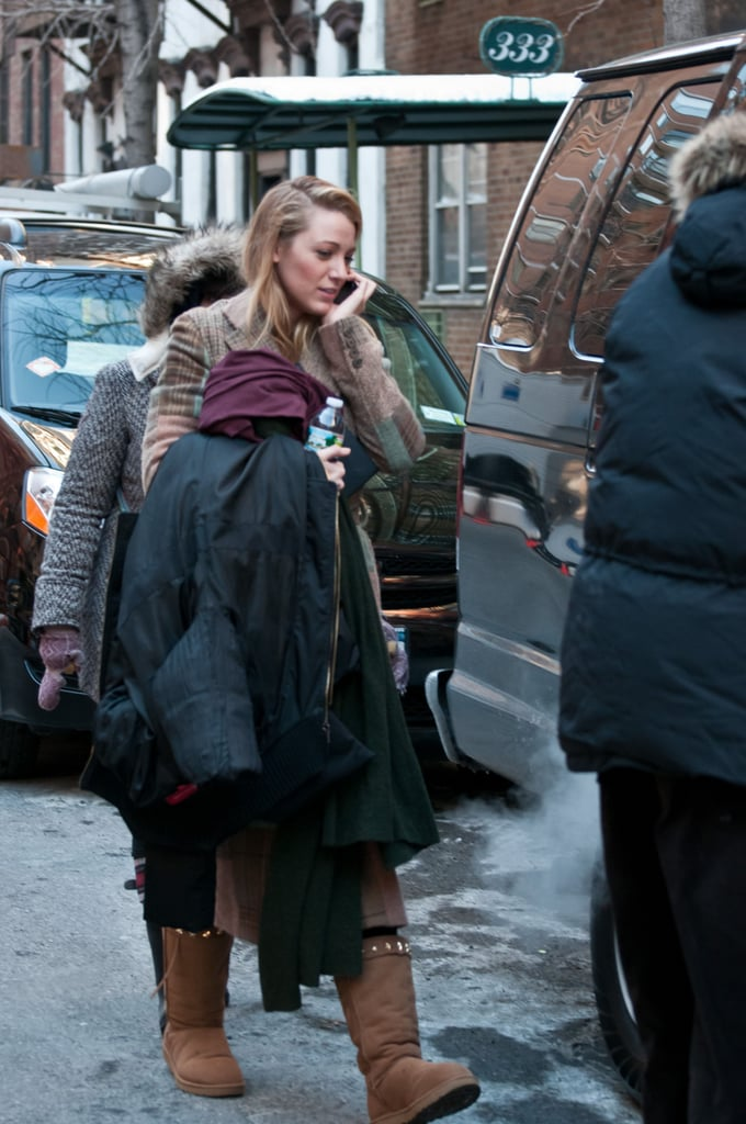 Blake Lively was on her phone yesterday as she made her way to the set of Gossip Girl in Manhattan, for another day's work filming the series. She kept warm in her big coat between takes, layering up in a Ralph Lauren patchwork coat too. The show's just returned to American screens after the Winter hiatus, and Blake's been out with her big screen costars too, collecting a best ensemble award.