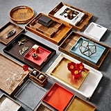 A tray is a powerful way to create a sense of order where there is cluttered chaos, especially on a coffee table or bar cart. These rectangle lacquer trays ($59-$69) make an attractive gathering place for books, candles, or flowers.