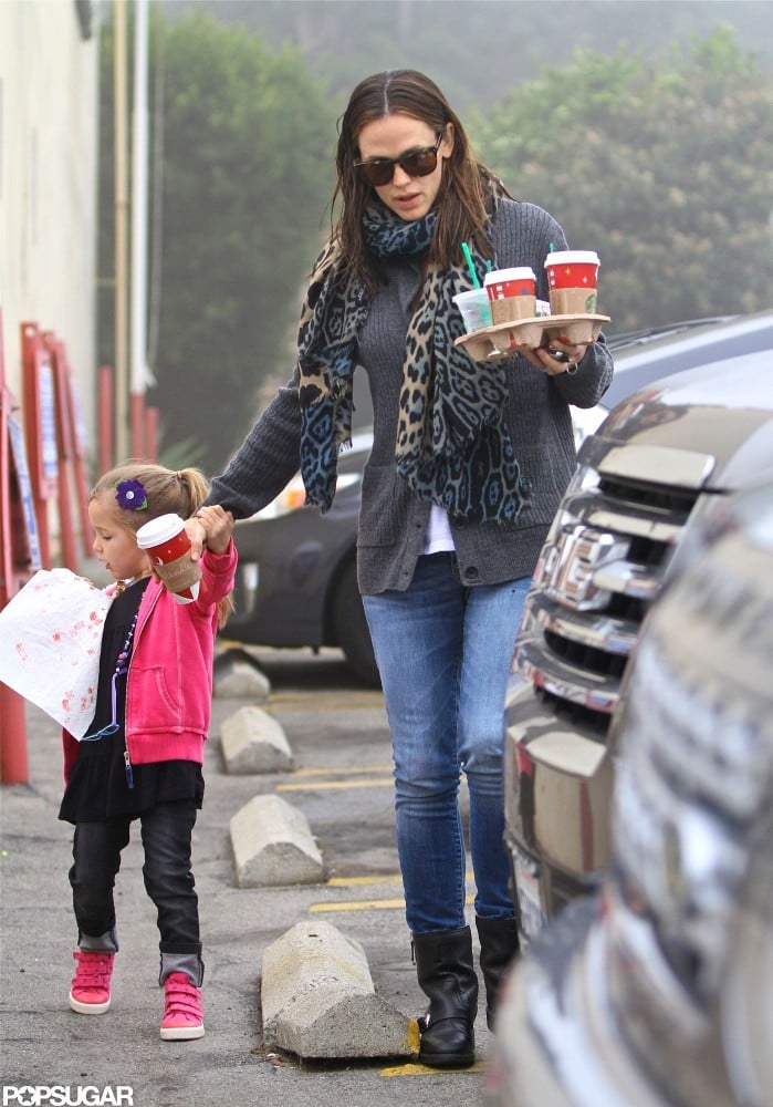 Jennifer Garner and her middle child, Seraphina Affleck, made a pit stop at one of their favorite Brentwood coffee joints today. The Starbucks regulars left with a full tray, which Jen balanced while holding Sera's hand on their way back to the car. Jen kept warm in a gray sweater and printed scarf, while Sera sported bright pink and purple — much like she did when she and her dad, Ben Affleck, stopped for coffee yesterday.  Ben's directorial duties have kept him busy this year, and Jen has worked on, and promoted, several films. Their A-list careers haven't stopped them from clocking in quality time with Seraphina and her siblings, Violet and Samuel — make sure to check out all of Ben and Jen's sweetest family moments of 2012.