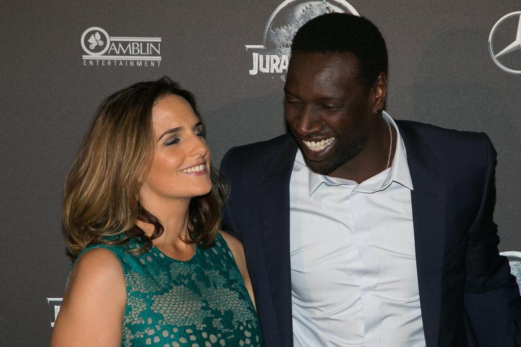 """If you've watched Lupin on Netflix, you've probably found yourself wondering about its star: Omar Sy. More specifically, his relationship status. Unlike the show, Omar is happily married to Siyah Organics CEO Hélène Sy and they have five children together. The two tied the knot in July 2007 after dating for ten years.  For their anniversary last year, Hélène shared a heartfelt tribute on Instagram, in which she reflected on their time together. """"I remember the day we got married, & I got to say I do. I knew my life had begun & I am thankful for everyday, the ups and even the downs, that you get to spend with me,"""" she wrote. """"I am so thankful for the amazing husband and friend you are to me. and the devoted loving father you are to our children.""""  As we wait for part two of Lupin to premiere on June 11, flip through some of Omar and Hélène's cutest moments ahead.      Related:                                                                                                           Enamoured With Lupin's Sleuthing and Thievery? Try These 10 Shows On For Size"""