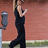 Gisele Bundchen played with her phone while walking home.