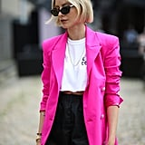 Go bright with a pair of high-waisted black shorts, cropped T-shirt, and bold blazer to amp up your look.