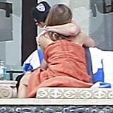 Jennifer Aniston and Justin Theroux kissed after soaking up the sun in Mexico in January 2013.