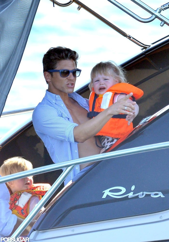 David Burtka held Harper Burtka-Harris as she wore a life vest.