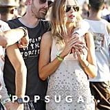 Kate Bosworth wore a cuff by Jennifer Fisher and a suede eyelet tank and short set from her upcoming collection for Topshop.