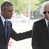 President Obama puts his arm on Vice President Biden during their visit to honor the victims of Orlando.