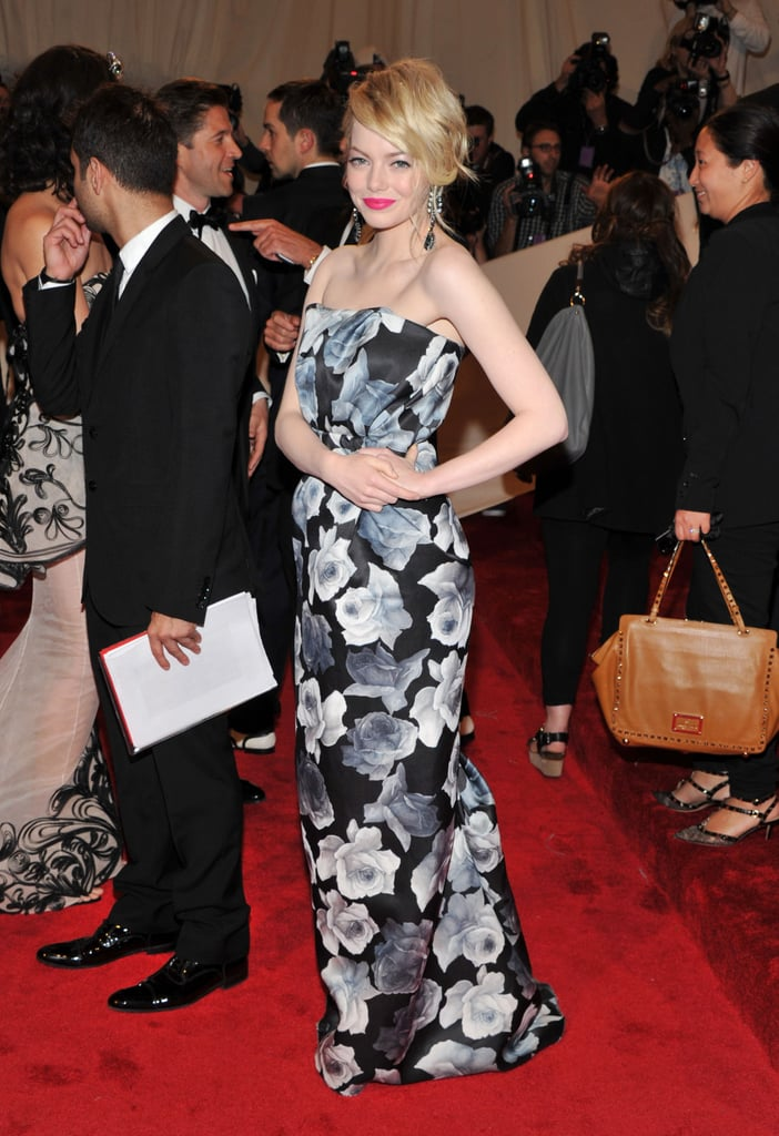 Emma Stone opted for a black and white flower-covered Lanvin gown paired with hot pink lipstick for the 2011 Met Gala tonight. Her good friend Taylor Swift, who wore J. Mendel hit the red carpet first, and said she was very excited to meet up with Emma inside the party. Emma Stone is in NYC filming The Amazing Spider-Man, but had the evening off to join all the stars at the Costume Institute's iconic event. What do you think of Emma's look? Weigh in on all the 2011 Met Gala red-carpet pictures with Fab and Bella's live love it or leave it polls!