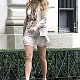 Blake paired a blazer over a belted mini-dress and cute green platform pumps.