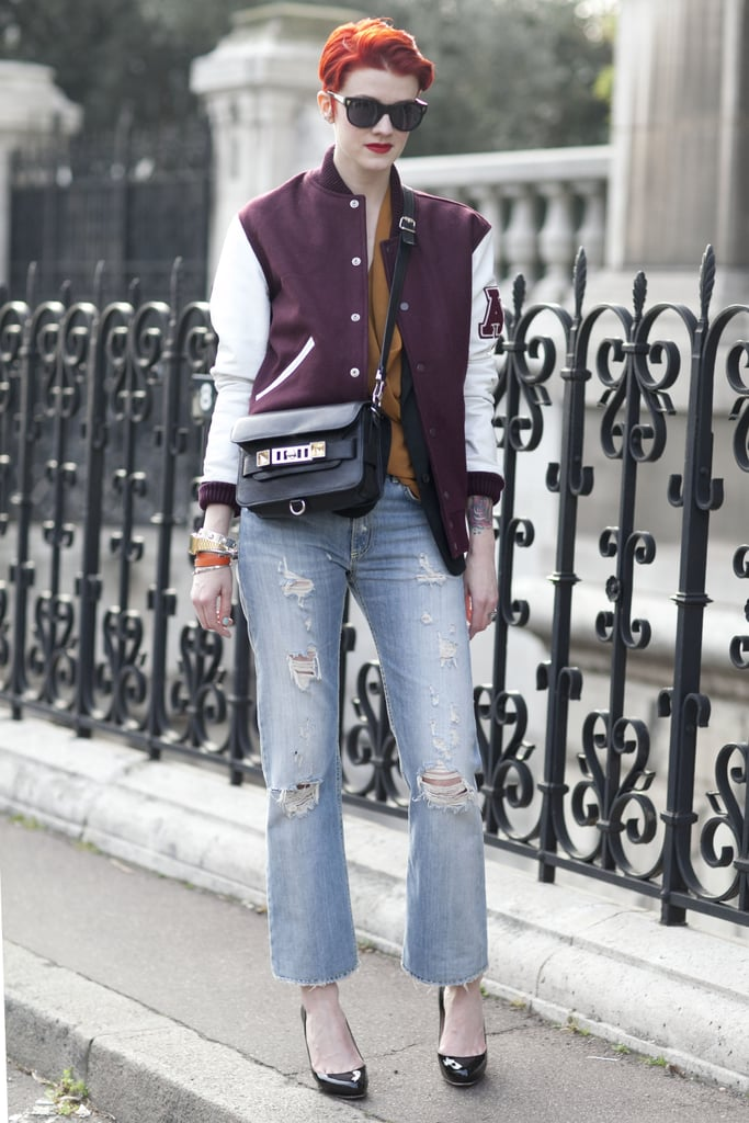 She wears the athletic trend like a champ, thanks to a shrunken (read: not too literal) varsity jacket juxtaposed with posh pumps.