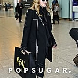 Madonna Carrying Her Gucci Bag Through the Airport