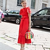 Wow them with a bright dress and equally standout bag.