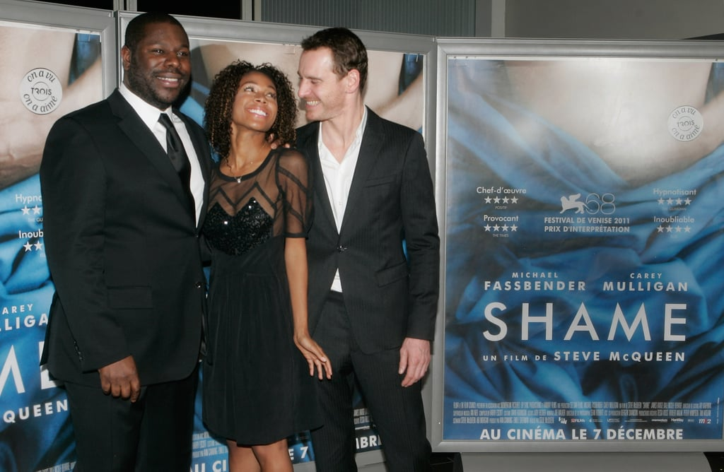 Michael Fassbender shared a look of love with Nicole Beharie, and their Shame director Steve McQueen at a November 2011 premiere in Paris.