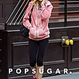 Gwyneth Paltrow wore a pink sweatshirt.