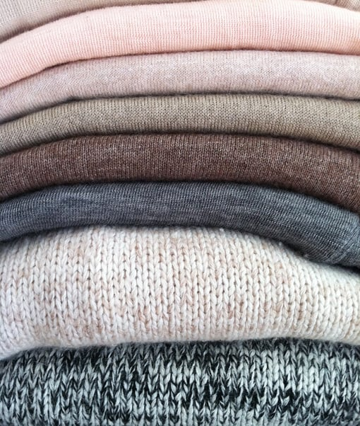 "I constantly fight the urge to arrange tops/knits by colour (so pretty!), but I find it's more practical separating them into winter and summer ""tops"". Nothing makes me happier than a neat pile of knits!"