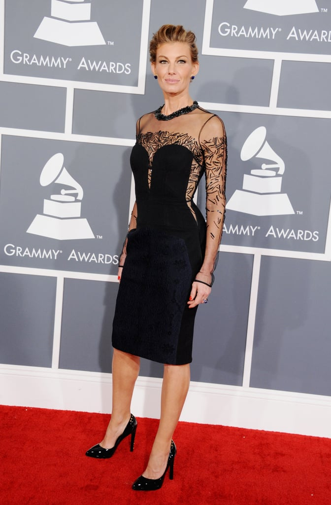 Faith Hill looked sexy and sophisticated in a sheer-sleeved lace-inset dress by J. Mendel.