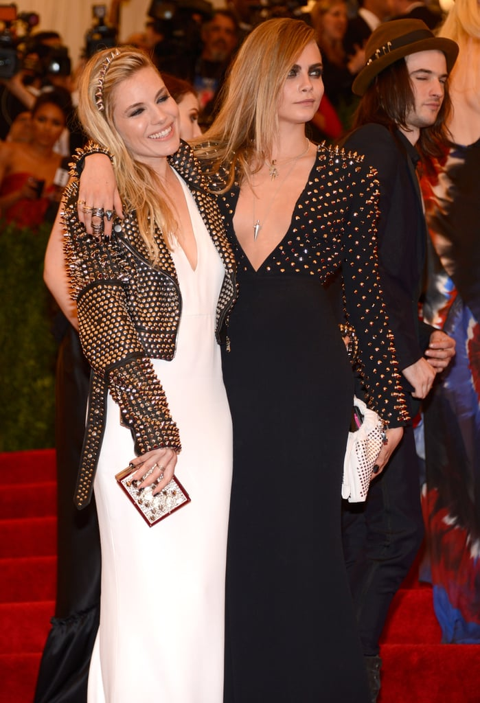 Sienna Miller met up with model Cara Delevingne when she wasn't busy posing with fiancé Tom Sturridge.