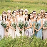This huge group of bridesmaids looked like a pastel dream in light purples, blues, beiges, and pinks.
