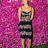 Bar Refaeli looked gorgeous in a sweet-meets-sexy floral-print dress.