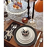 Mixed and matched Halloween decor looks eclectic and welcoming on this tabletop — and makes us wish we were attending the dinner party!