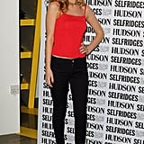 Georgia May Jagger promoted her denim line in super-sexy skinnies, sky-high pumps, and a flirty pop of red.