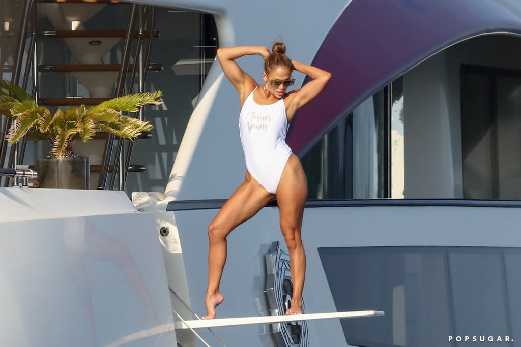 "Jennifer Lopez White Swimsuit That Says ""Forever Young"""