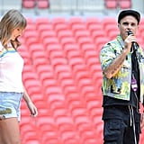 Taylor rehearsing with Robbie Williams in the Madewell High-Waist Embroidered Denim Shorts and the Elizabeth and James Lakota T-Shirt ($115).